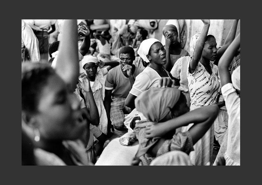 Prédicateur évangéliste et ses disciples, Port au Prince, Haïti 1984.